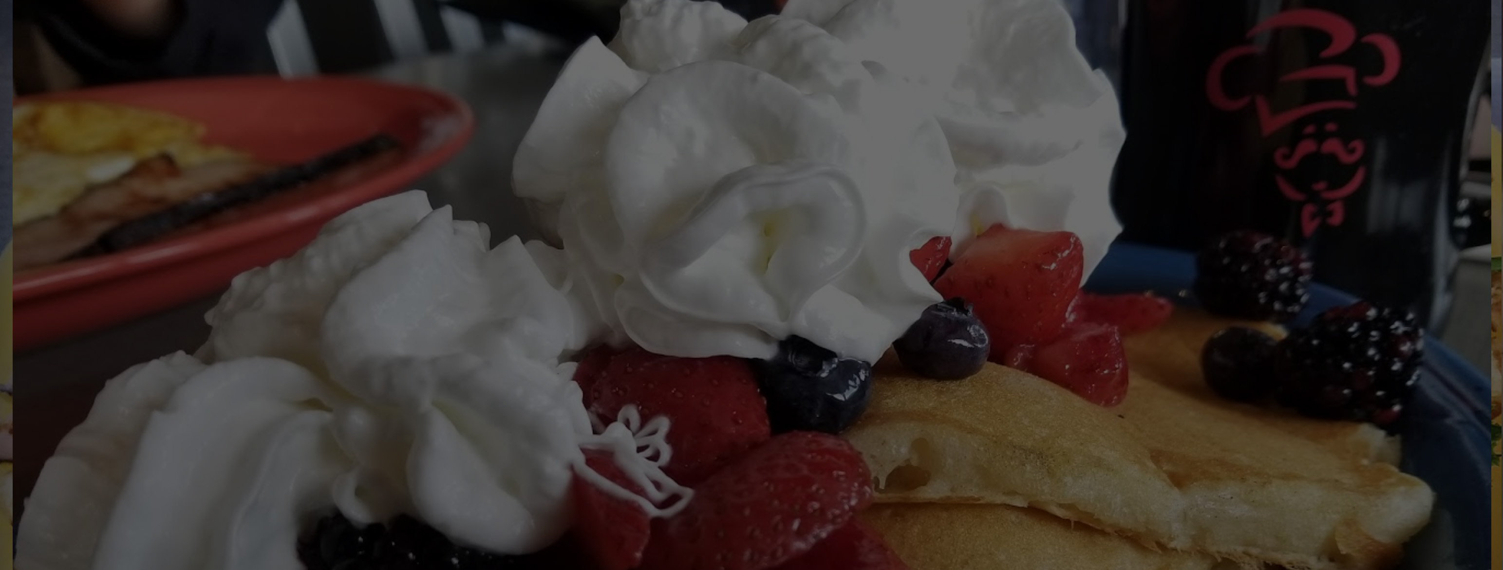 breakfast with pancakes berries and whipped cream